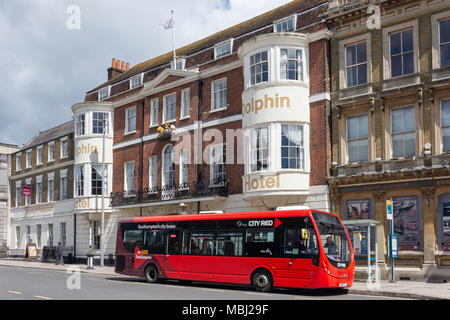 First City Red bus outside The Dolphin Hotel, High Street, Southampton, Hampshire, England, United Kingdom - Stock Photo