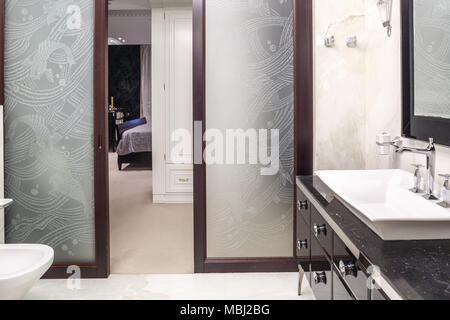 cozy and bright bathroom interior with marble walls and floor - Stock Photo