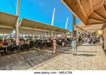 Tourists enjoy a cafe on a sunny day at Riva Promenade along the harbor of the Adriatic sea on the Dalmation Coast of Split, Croatia - Stock Photo