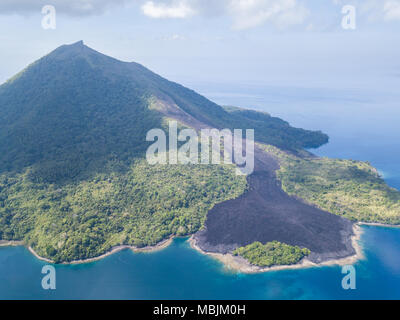 A recent lava flow is seen from a birds eye view on Banda Neira in the Banda Sea. This region is in the Coral Triangle and has high biodiversity. - Stock Photo