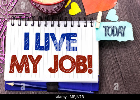 Handwriting text writing I Live My Job Motivational Call. Concept meaning Be immerse in and love Work Enjoy Business written Notebook Book the Wooden  - Stock Photo