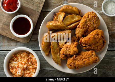Delicious homemade crispy fried chicken with taters and coleslaw. - Stock Photo