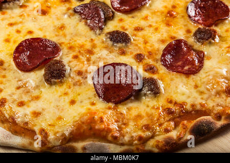 Pizza with salami and pineapple - Stock Photo