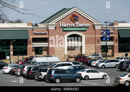 A logo sign outside of a Harris Teeter grocery retail store location in Olney, Maryland on April 10, 2018. - Stock Photo