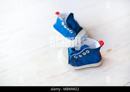 Pair of new blue sneakers on white background - Stock Photo
