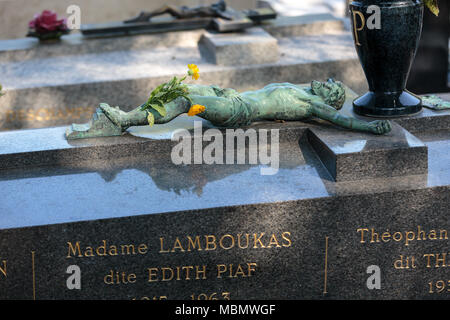 PARIS, FRANCE - SEPT 12, 2014: Edith Piaf grave in Pere-Lachaise cemetery, Paris, France - Stock Photo