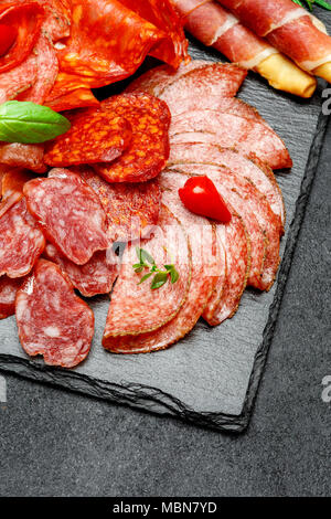 Cold meat plate with salami and chorizo sausage and parma - Stock Photo