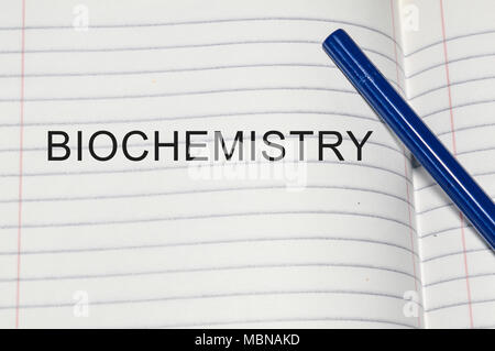 biochemistry word written on white paper - Stock Photo