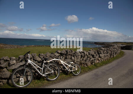 Adult's bike with tagalong attachment - Stock Photo