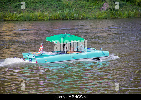 Amphic car, a german amphibious vehicle driving on Moselle at Cochem, Rhineland-Palatinate, Germany