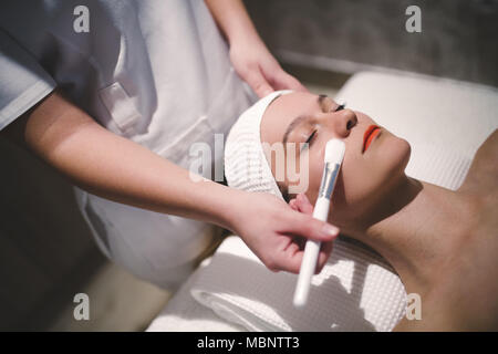 Cosmetic and massage treatment at wellbeing saloon - Stock Photo