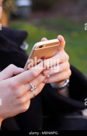 Hand held iPhone on a camping trip. - Stock Photo
