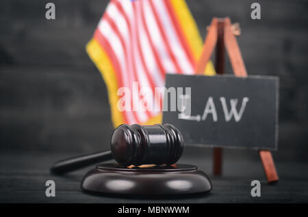Law and Justice, Legality concept, Judge Gavel, Blackboard and United States of America flag on a black wooden background. - Stock Photo