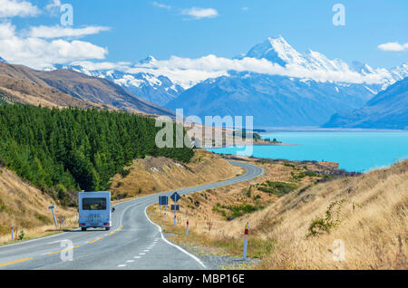 new zealand south island new zealand  motor home travelling on a winding road to mount cook national park by the side of lake pukaki new zealand - Stock Photo