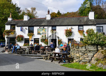 The Britannia Inn in the village of Elterwater in the Lake District National Park in Cumbria, England - Stock Photo
