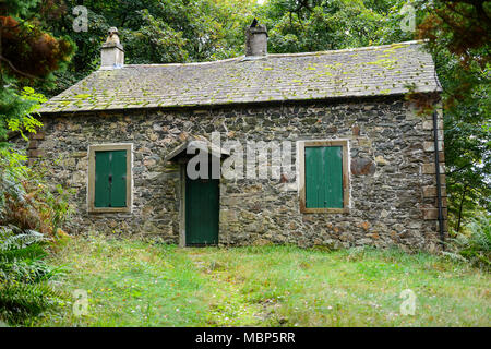 Old stone cottage near the Bowder Stone in Borrowdale in the Lake District National Park in Cumbria, England - Stock Photo