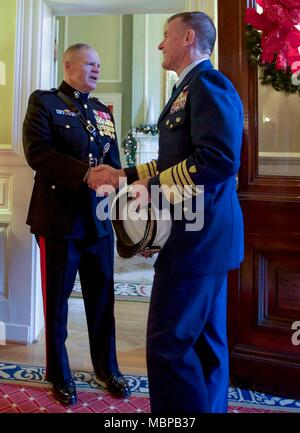 Commandant of the Marine Corps Gen. Robert B. Neller, left, shakes hands with Commandant of the Coast Guard, Adm. Paul F. Zukunft before the 2018 Surprise Serenade at the Home of the Commandants, Washington, D.C., Jan. 1, 2018. The Surprise Serenade is a tradition that dates back to the mid-1800's in which the U.S. Marine Band performs music for the Commandant of the Marine Corps at his home on New Years Day. (U.S. Marine Corps photo by Sgt. Olivia G. Ortiz) - Stock Photo