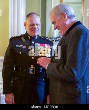 Commandant of the Marine Corps Gen. Robert B. Neller, left, welcomes Secretary of the Navy, Richard V. Spencer before the 2018 Surprise Serenade at the Home of the Commandants, Washington, D.C., Jan. 1, 2018. The Surprise Serenade is a tradition that dates back to the mid-1800's in which the U.S. Marine Band performs music for the Commandant of the Marine Corps at his home on New Years Day. (U.S. Marine Corps photo by Sgt. Olivia G. Ortiz) - Stock Photo