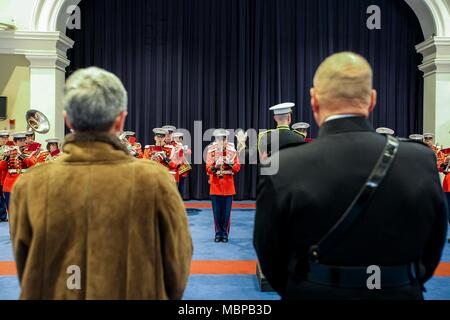 Commandant of the Marine Corps Gen. Robert B. Neller and wife, D'Arcy Neller watch the U.S. Marine Band during the 2018 Surprise Serenade at Marine Barracks Washington, Washington, D.C., Jan. 1, 2018. The Surprise Serenade is a tradition that dates back to the mid-1800's in which the U.S. Marine Band performs music for the Commandant of the Marine Corps at his home on New Years Day. (U.S. Marine Corps photo by Sgt. Olivia G. Ortiz) - Stock Photo