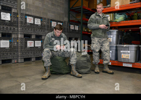 More than a dozen Airmen, assigned to the 105th Airlift Wing, gather cold weather gear and prepare to respond to heavy snow and wind at Stewart Air National Guard Base Jan. 4, 2017. The Airmen are tasked as part of New York state's Initial Response Force to help local officials mitigate the destruction of such weather events. (U.S. Air Force photo by Staff Sgt. Julio A. Olivencia Jr.) - Stock Photo