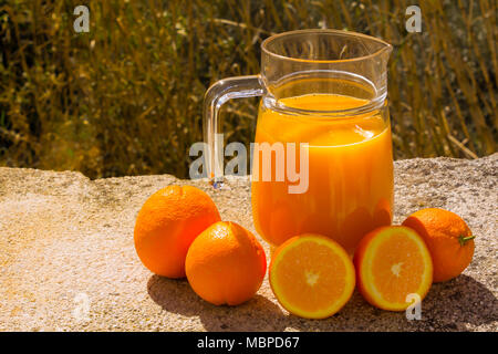 Pitcher of Freshly squeezed Orange Juice, with fresh Oranges, Outside with a Natural Backdrop, March 2018, Almeria Andalucia Spain. - Stock Photo