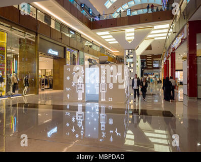 DUBAI,UAE - DECEMBER, 2017: People shopping inside the Dubai Mall, one of the bigest in the world - Stock Photo