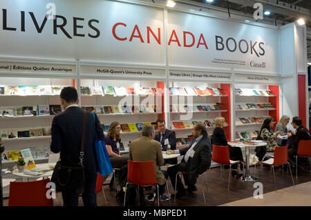 London,UK.10th April 2018. Exhibitors and visitors at the Canada stand at London Book Fair 2018 at the Olympia Exhibition Centre. London. - Stock Photo