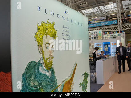 London,UK.10th April 2018. Exhibitors and visitors at the Bloomsbury stand at  London Book Fair 2018 at the Olympia Exhibition Centre. London. - Stock Photo