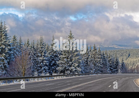 Winter landscape and motorway in Harz national park near Braunlage, Germany - Stock Photo