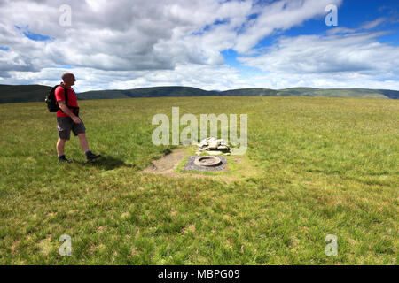 Walker, Summit cairn on Branstree Fell, Mardale Common, Lake District National Park, Cumbria County, England, UK - Stock Photo