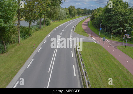 Empty Road With Bicycle Path At The Netherlands - Stock Photo