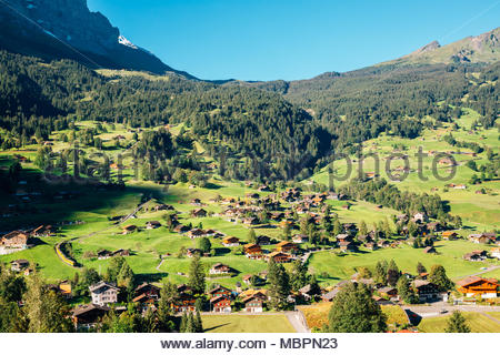Grindelwald village, mountain and wooden houses in Switzerland - Stock Photo