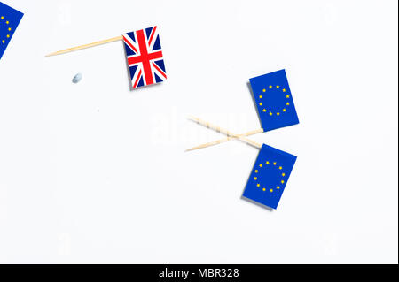 One Union Jack flag and two European Union flags on a white background - Stock Photo
