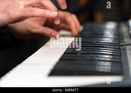 Hands of a pianist close-up. Plays on the synthesizer - Stock Photo