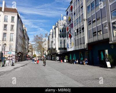 Earlyorning on the pedestrian street rue Aubry le Boucher, people sitting outside a Starbucks in the 4th Arrondissement, Paris, France. - Stock Photo