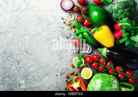 Set of fresh vegetables on grey background. Aromatic herbs, onion, avocado, broccoli, pepper bell, eggplant, cabbage, radish, cucumber, almonds, rucola, baby corn. Banner - Stock Photo