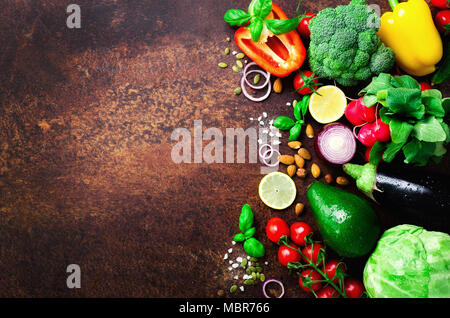 Set of fresh vegetables on brown background. Aromatic herbs, onion, avocado, broccoli, pepper bell, eggplant, cabbage, radish, cucumber, almonds, rucola, baby corn. Banner - Stock Photo