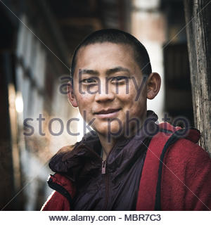 A portrait of a young monk who lives in the remote Tengchu Goemba, Bhutan. - Stock Photo