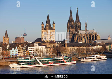 City view with Rhine, town hall tower, church Groß Sankt Martin and Cologne Cathedral, old town, Cologne - Stock Photo