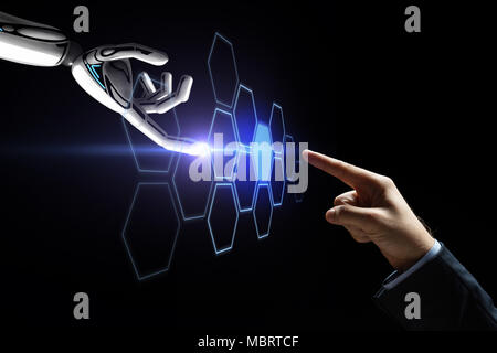 robot and human hand touching network hologram - Stock Photo