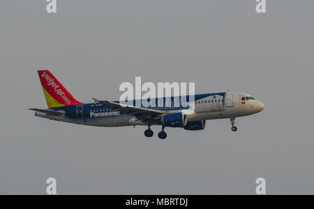 Saigon, Vietnam - Mar 11, 2018. A civil aircraft is landing at Tan Son Nhat Airport in Saigon (Ho Chi Minh City), Vietnam. - Stock Photo