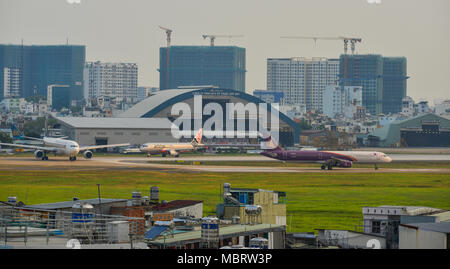 Saigon, Vietnam - Mar 11, 2018. Aircrafts on runway at Tan Son Nhat Airport in Saigon (Ho Chi Minh City), Vietnam. - Stock Photo