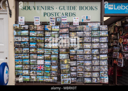 Shop frontage with display of postcards for sale. Cambridge England UK - Stock Photo