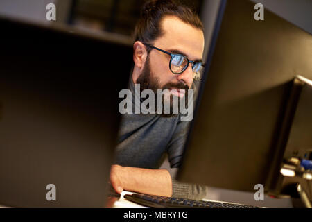 close up of creative man working at night office - Stock Photo