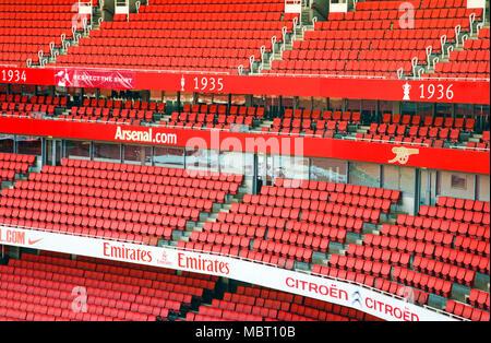 Red colored stands in Highbury Stadium. Highbury Stadium, Highbury, United Kingdom. Architect: Archibald Leitch, William Binnie, Claude Ferrier, 1913.
