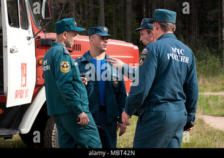 Yartsevo, Russia - August 26, 2011: Employees of the Ministry of Emergency Situations Russia speak at the fire engine - Stock Photo