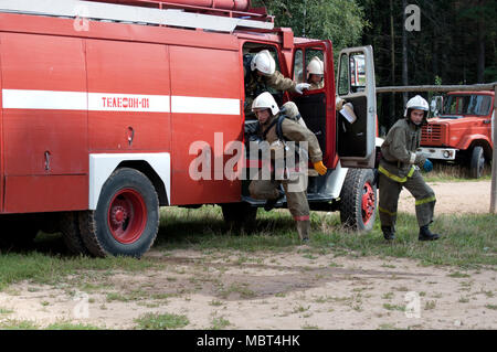 Yartsevo, Russia - August 26, 2011:  Firefighters run out of the fire engine - Stock Photo