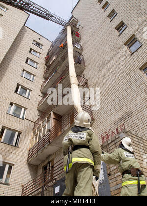 Yartsevo, Russia - August 26, 2011: Firefighters spread out the rescue sleeve - Stock Photo
