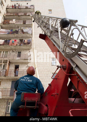 Yartsevo, Russia - August 26, 2011: The fireman is climbing the rescue ladder - Stock Photo
