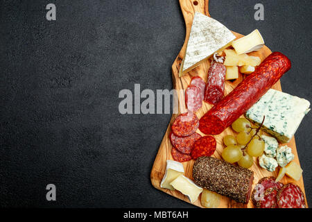 Cold meat cheese plate with salami sausage and cheese - Stock Photo